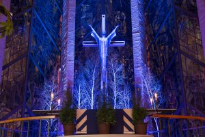 The Chapel chancel is bathed in blue and purple lights.