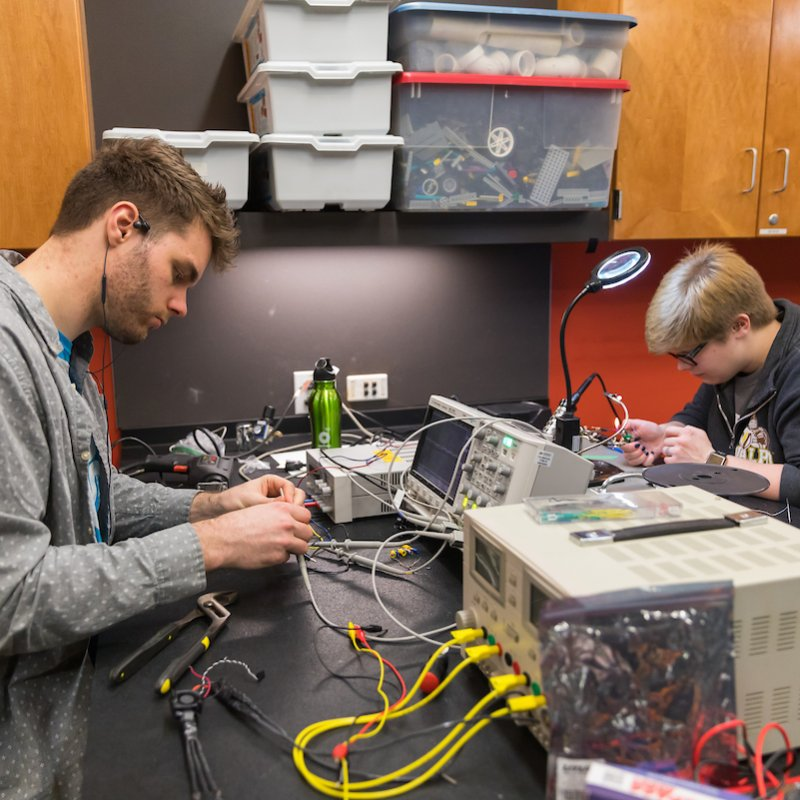 Electrical engineering students apply their skills to hands-on work.