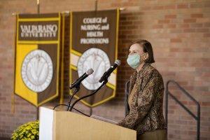 Interim President-Elect Colette Irwin-Knott '81 speaking from podium