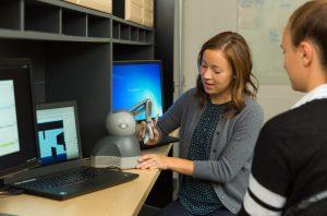 Reva Johnson working with robotic equipment
