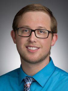 Blue shirt, glasses, man