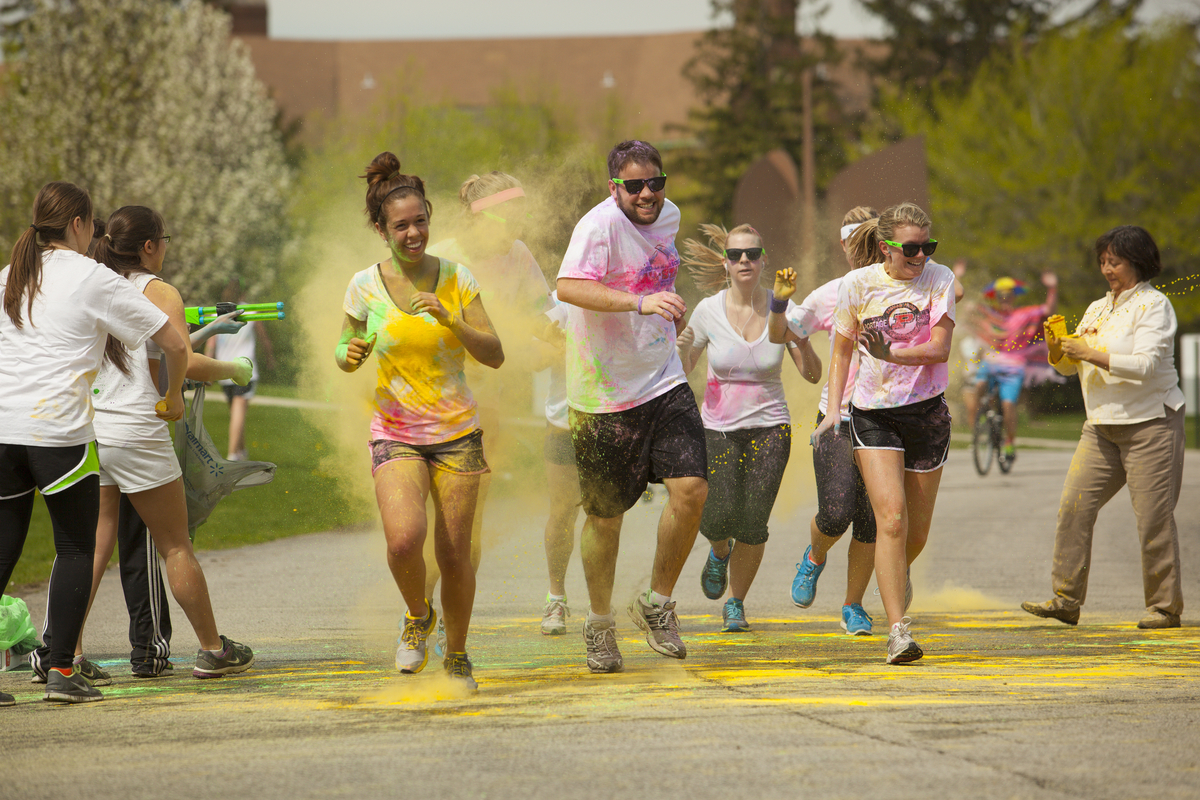 Jeff Lange | The Vindicator JUNE 13, - McDonald High School senior Matt Howard (left center) screams and dances with other runners of the Color Run in Youngstown, Saturday afternoon.