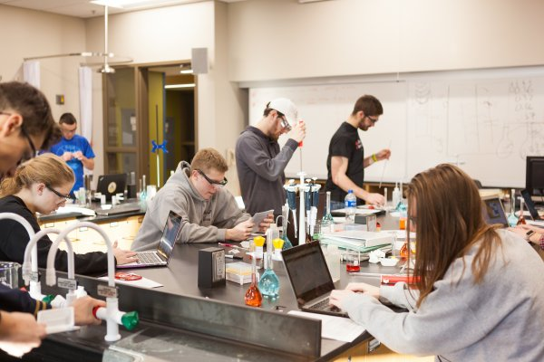 Valpo students conducting experiments in a chemistry lab